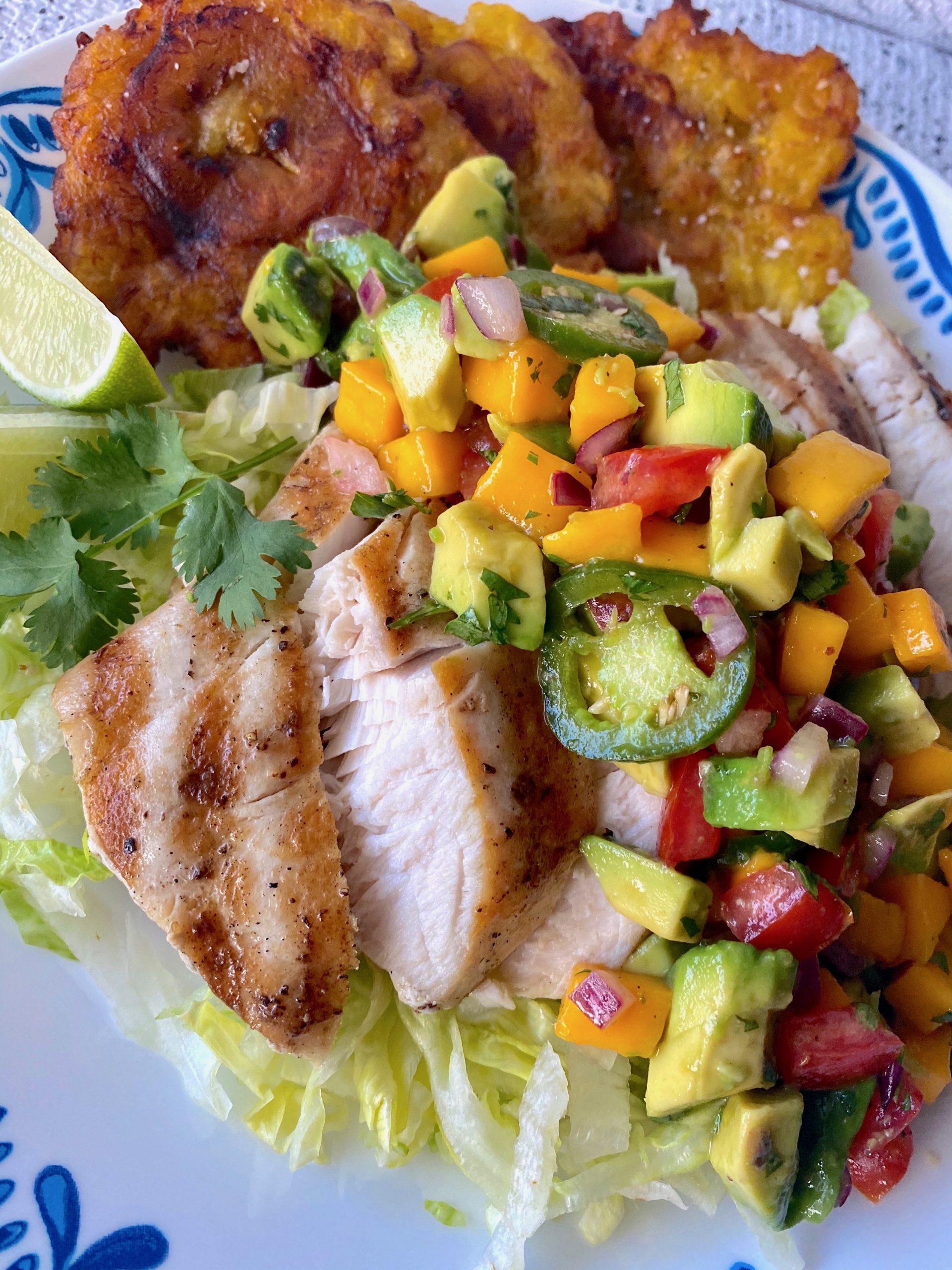 Grilled fish with mango & salsa on top